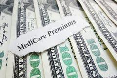 Medicare premiums headline. Closeup of Medicare Premiums newspaper headline on cash royalty free stock image