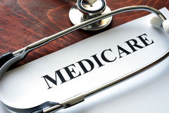Medicare. Word medicare written on a paper and stethoscope Royalty Free Stock Images