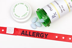 Medication Allergy. Allergy alert hospital wristband with medication and prescription bottle Stock Photography