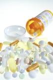 Medication and bottle. Medication spilling out of bottle with backlit lighting Stock Images
