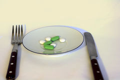 Medication for the Businessman's lunch Stock Images