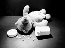 Medication and children. Bear with pills 3 stock photo