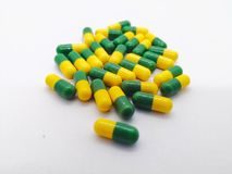 Medication concept. Tramadol is generic name of narcotic- like p. Ain reliever, used to treat moderate to severe pain. Many yellow-green capsules isolated on Stock Photography