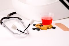 Medication in cup. Different kind of form medication and 30cc cup stock images