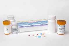 Medication Dispenser. Daily medication dispenser with pills and prescription bottles Stock Photos