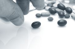 Medication. Human hand taking pill close-up Stock Photos