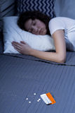 Medication necessary to obtain good night's sleep Stock Image
