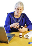 Medication Online. Senior woman using buying her medication online Stock Images