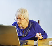 Medication Online. Senior woman using buying her medication online Royalty Free Stock Photography