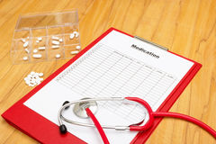 Medication plan with pill box Royalty Free Stock Photo