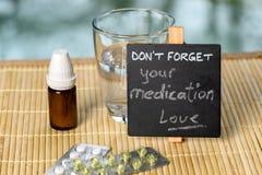 Medication reminder on bamboo Stock Images