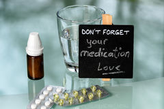 Medication reminder on glas table Royalty Free Stock Images