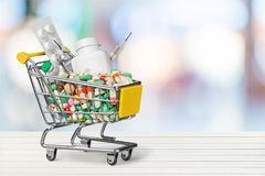 Medication shopping cart. Whitespace copyspace retail discount bulk shop Stock Photo