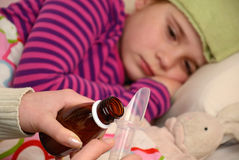 Medication for sick little girl Royalty Free Stock Photography