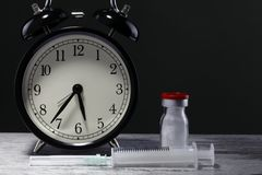 Medication time. Photographed clock in the studio environment and drug Stock Photo