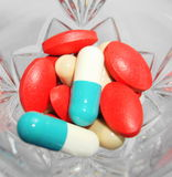 Medications cocktail. Cocktail of medications of different colors Stock Image