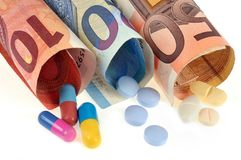 Medications coming out of euro banknotes stock images