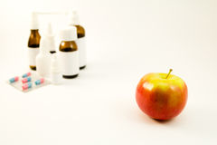 Medications and fruits Royalty Free Stock Photography
