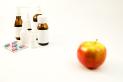 Medications and fruits Stock Images