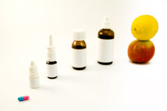 Medications and fruits Royalty Free Stock Images