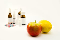 Medications and fruits Stock Photos