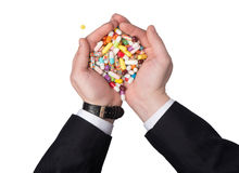 Medications in the hands of man royalty free stock photos