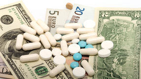 Medications and money. Royalty Free Stock Images