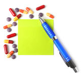 Medications, pen and paper for a prescription. Stock Photography