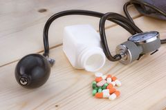 Medications and portable blood pressure monitors. Lay on the woo. D floor stock photos