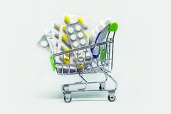medications in the shopping basket. royalty free stock photography