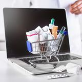 Medications in small shopping cart stock images