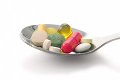 Medications in spoon Royalty Free Stock Photo