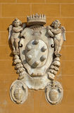 The Medici family embleme. On a wall of Miracle's Place in Pisa royalty free stock image