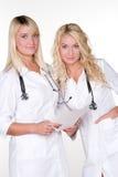 Medici femminili sorridenti fotografia stock