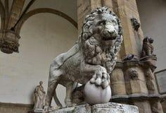 Medici Lion holds the globe in Piazza della Signoria Stock Photos