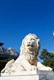 Medici lion near Alupka Palace and Ai-Petri peak. Medici lion near Vorontsov (Alupka) Palace and Ai-Petri peaks, Crimea royalty free stock images