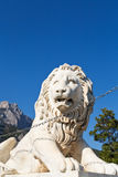 Medici lion near Alupka Palace and Ai-Petri rock. Medici lion near Vorontsov (Alupka) Palace and Ai-Petri rock, Crimea stock image