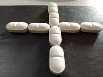 Medicina blanca de la tableta de la farmacia de la muestra imagenes de archivo