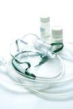 Medicina de la máscara y del líquido con un nebulizador. Fotos de archivo