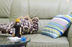Medicina e o sofá Foto de Stock