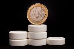 Medicina e soldi Fotografie Stock Libere da Diritti