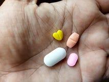 Medicina na mão da palma fotos de stock royalty free