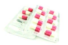 Medicina rosada y blanca fotografía de archivo libre de regalías