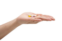Medicina in una mano su fondo bianco Fotografia Stock