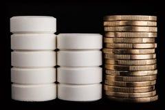 Medicina y dinero fotos de archivo