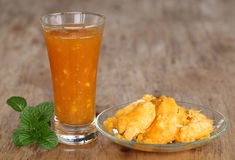 Medicinal Bael fruit with juice and mint leaves Stock Photos