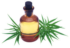 Medicinal cannabis leaves with extract oil in a bottle Stock Photos