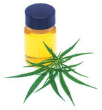 Medicinal cannabis leaves with extract oil in a bottle Royalty Free Stock Images