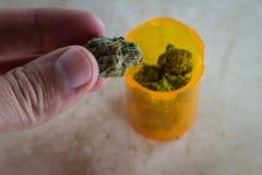 Medicinal cannabis in a prescription bottle Stock Image