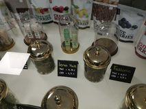 Medicinal CBD marijuana, oil and treats in a display case of a shop in the center of Kortrijk. stock photography